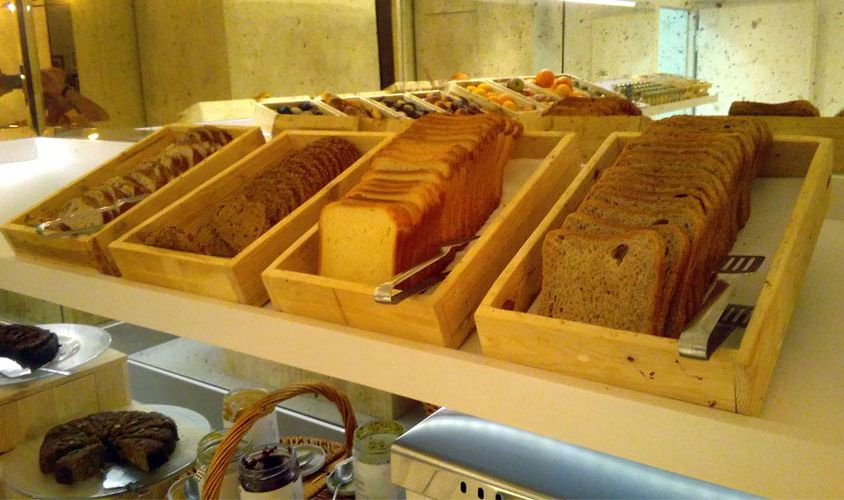 Tray of pastry and box of baguettes